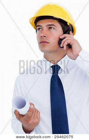 Close up of male architect listening to caller against a white background