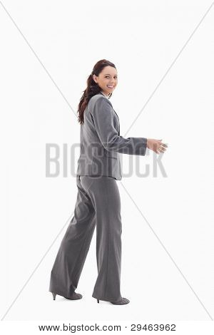 Businesswoman smiling and shaking hands against white backgroung