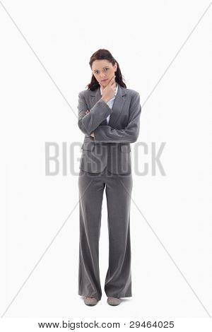 Businesswoman with the hand on her chin against white background