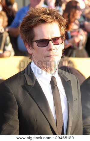 LOS ANGELES - JAN 29:  Kevin Bacon arrives at the 18th Annual Screen Actors Guild Awards at Shrine Auditorium on January 29, 2012 in Los Angeles, CA