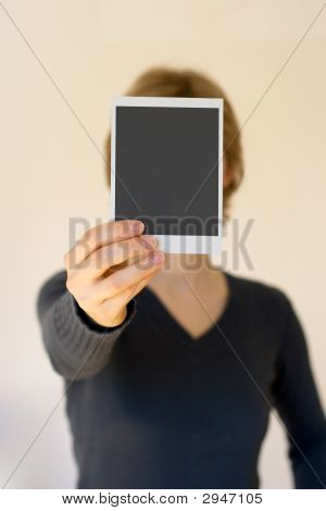 Woman Holding Empty Card In Front
