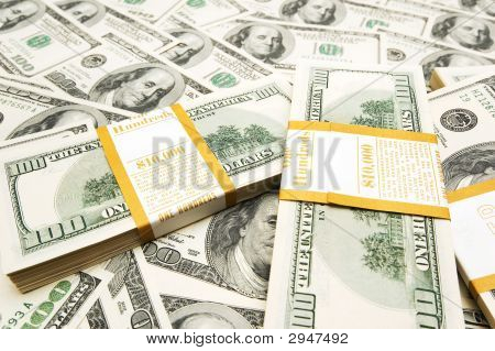 Ten Thousand Dollar Stacks On Money Background