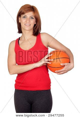 Beautiful redhead girl with a basketball isolated on a over white background