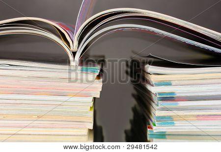 stacks of magazines on gray background