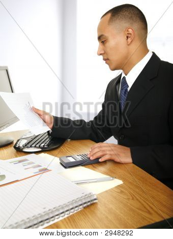 Business Man Looking At Chart
