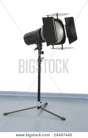 studio photoflash stands on a tripod