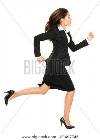 Business woman running in suit in full body isolated on white background. Business concept image with young mixed race Caucasian / Chinese Asian businesswoman.