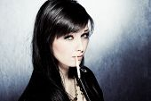 image of smoking woman  - black hair woman in leather jacket - JPG