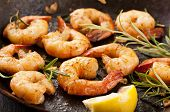 stock photo of tiger prawn  - fried prawns with fresh rosmarin and lemon juice - JPG