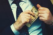 Businessman Gives A Bribe To An Employee In The Office. Concept - Corruption. Giving A Bribe. Money  poster