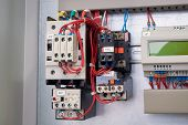 Starting Assembly Of Contactors And Thermal Relays In The Electrical Cabinet. Right Controller For R poster