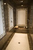 stock photo of bathroom sink  - Luxurious tiled shower in a modern bathroom - JPG