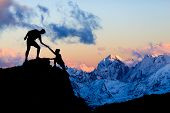 Teamwork Couple Helping Hand, Trust In Mountains. Team Of Climbers Man And Woman Hiking, Help Each O poster