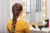 Woman With Braided Hair In Professional Salon poster