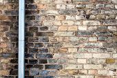 Old Wall With Drainpipe poster