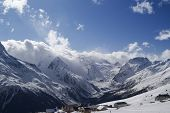 foto of snow capped mountains  - Cafe and hotels in high mountains - JPG