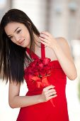 stock photo of matron  - Beautiful Sexy Asian Woman in red dress for Valentines Day - JPG