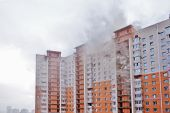 High-rise Condominium Or Apartment Burning. Fire In Apartments Of A Large Tenement-house. Fire On Se poster