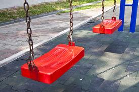 stock photo of school child  - Swings for children - JPG