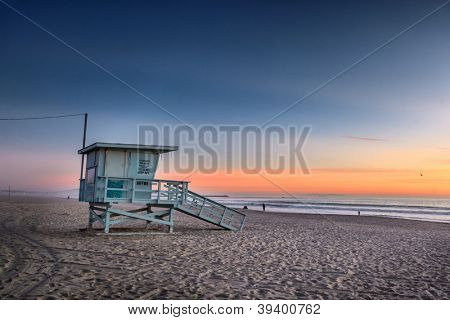 Lifeguard tower at Venice Beach, California at sunset.