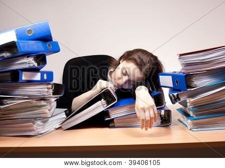 Businesswoman Sleeping At Office