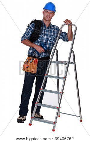 Tradesman standing next to a stepladder
