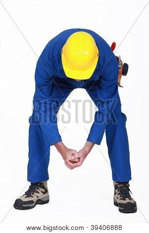 Worker bending over