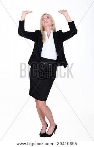 Woman raising arms towards the sky