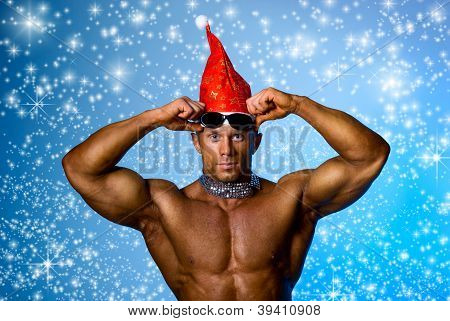 Strong Athletic Man In A Cap Of Santa Claus.