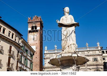 Fountain And Statue Of Madonna On Piazza Delle Erbe In Verona, Veneto, Italy