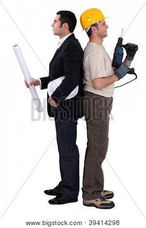 Tradesman and engineer standing back to back