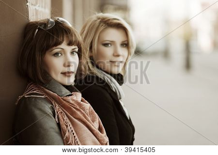 Young women against a wall