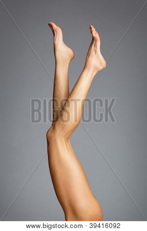 Beautiful female legs on a studio background