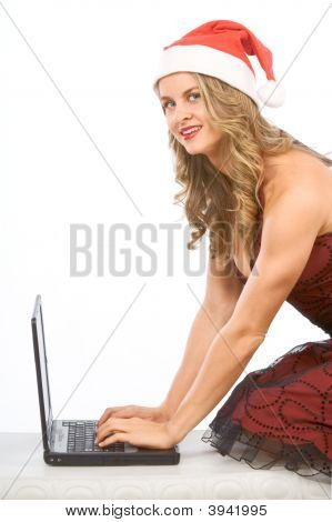 Sexy Mrs Santa Claus And Portable Laptop Computer