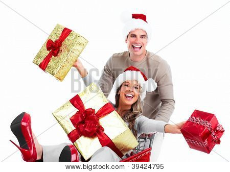 Happy young Christmas couple with  gifts isolated on white background.