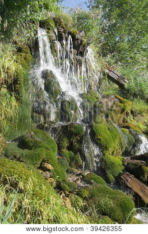 small waterfall and moss in the National Park of Theth, Albania