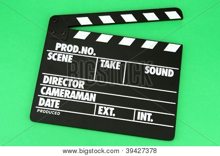 Movie production clapper board on color background