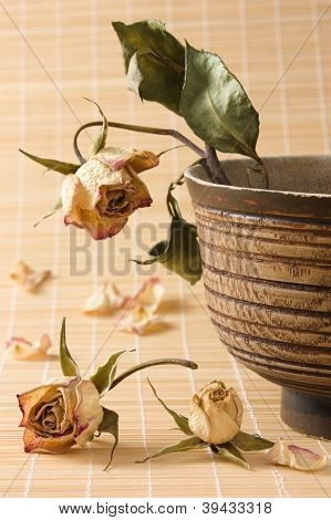 Dry Rose With Leaves In Wooden Bowl Still-life