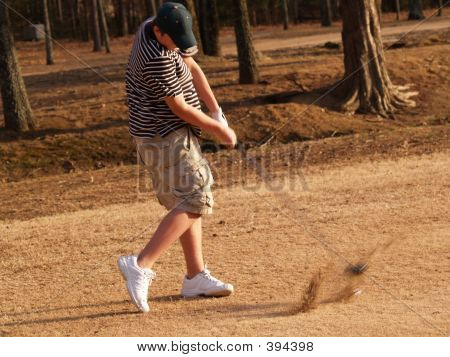 Teen Hitting The Ball