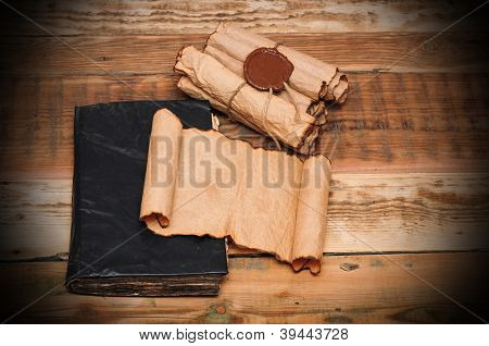 Scrolls of vintage paper with old book