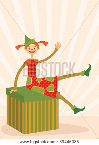 Christmas elf sitting on a gift box