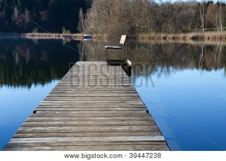 Wooden Jetty on a bathing lake in Bavaria, Germany