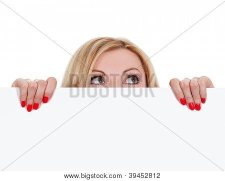 woman looking over empty white board, isolated on white background