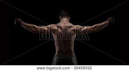 Muscular naked man from back