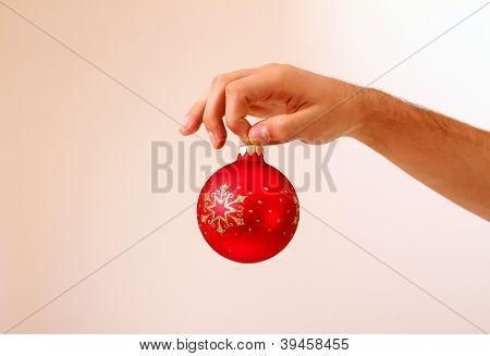 Man's Hand Holding Christmas Ball Isolated
