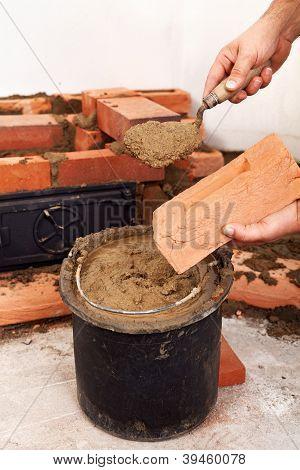 Masonry Worker Hands Closeup