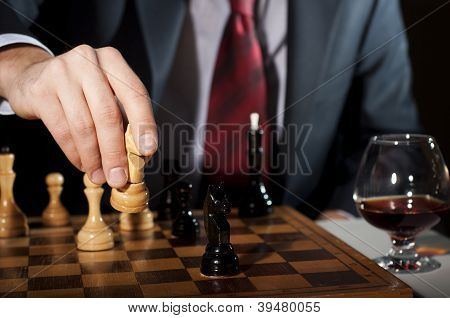businessman plays chess