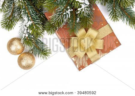Gift box and christmas decor under snowy fir tree. Isolated on white background