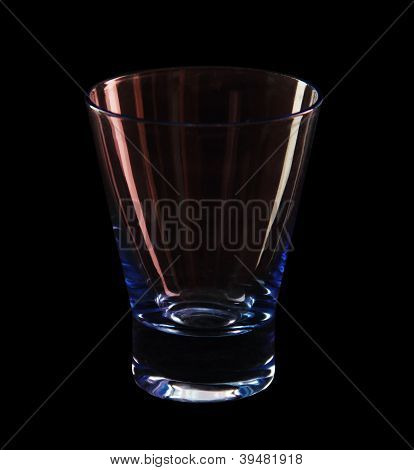 A Glass On A Black Background. Colored Highlights.