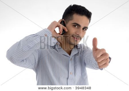 Man Talking On Cell Phone And Wishing Goodluck